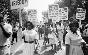 a black and white photo of black women leading a civil rights protest