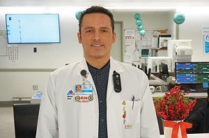 A male doctor is pictured in a white coat.