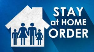 """An outline of a house with four gendered figures under one roof, and the words """"stay at home order"""""""